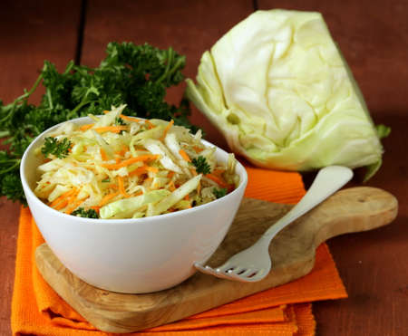 Traditional coleslaw  cabbage salad, carrot and mayonnaise  Imagens