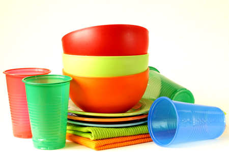 colored plastic tableware  cups, bowls, plates  photo