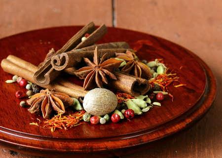 various spices  nutmeg, cinnamon, star anise, saffron, pepper, cardamom, fennel  photo