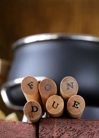 special fondue forks with letters soft focus photo