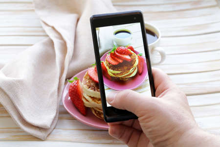 smartphone shot food photo  - pancakes for breakfast with fresh strawberries Stock Photo