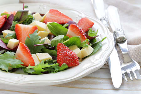 gourmet salad with fresh strawberries and cheese photo