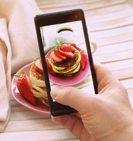 smartphone shot food photo  - pancakes for breakfast with fresh strawberries Stock Photo - 26300199