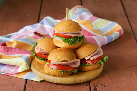 mini burgers with ham and vegetables - snacks for parties and picnics photo