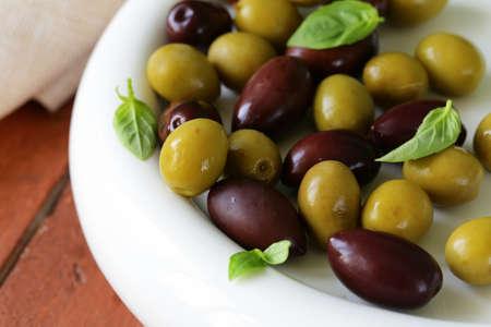 kalamata: marinated green and black olives  Kalamata  in a ceramic bowl Stock Photo