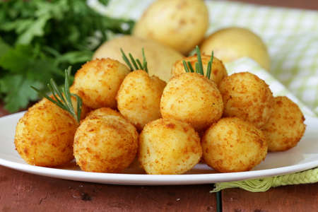 fried potato balls  croquettes  with rosemary