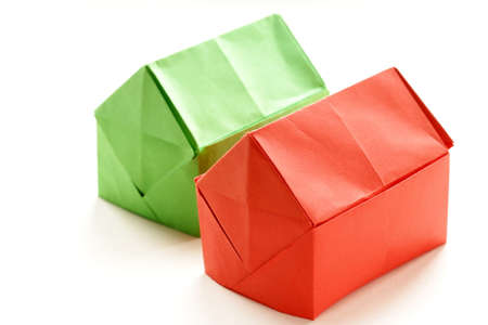 colorful origami paper houses on a white background photo