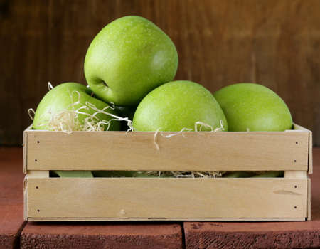 Granny Smith green apples in a wooden box photo