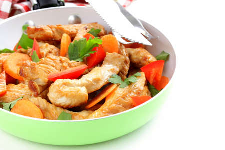 fried chicken  turkey  fillets with vegetables in a pan  photo