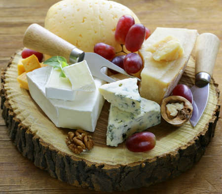 cheeseboard with assorted cheeses  parmesan, brie, blue, cheddar
