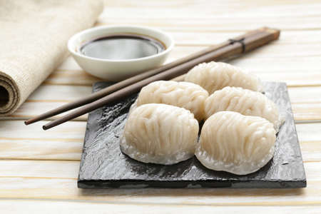 sum: Asian steamed meat dumplings dim sum with soy sauce