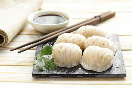 japanese meal: Asian steamed meat dumplings dim sum with soy sauce