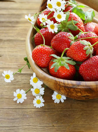 basket of fresh ripe strawberries - summer berries rustic style photo