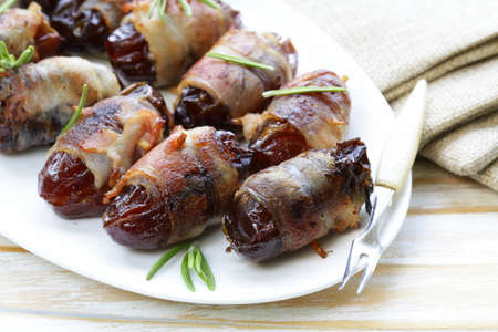 delicacy: appetizer delicacy dates wrapped in bacon and fried