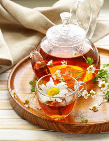 Organic herbal green tea with fresh chamomile flowers photo
