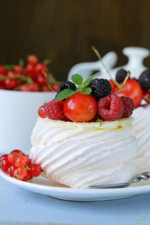 traditional summer dessert pavlova with fresh berries photo