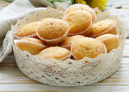 vanilla cupcake: homemade vanilla muffins in a basket of lace napkins