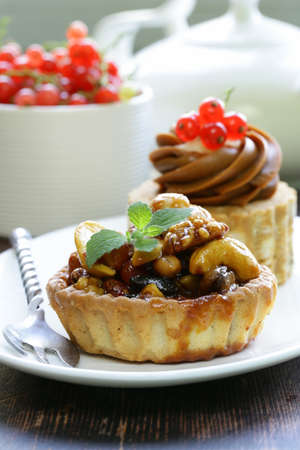 small dessert pastries with nuts and berries for tea time photo