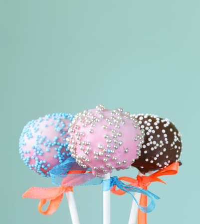 Variety of colorful cake pops - chocolate, vanilla and caramel flavors photo