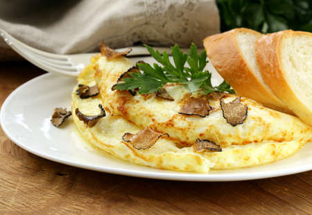 omelette: gourmet omelette with black truffle and herbs Stock Photo