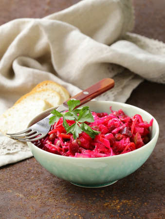 traditional Russian salad of beetroot and pickled cabbage (vinigret) photo