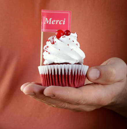 festive red velvet cupcakes with a gift compliment card photo