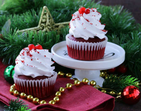 festive red velvet cupcakes Christmas table setting photo