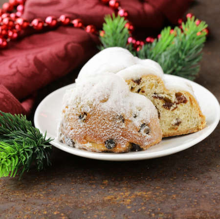 traditional Christmas stollen cake with raisins and powdered sugar photo