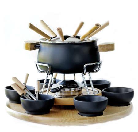 utensilios de cocina: juego de ollas para fondue Foto de archivo