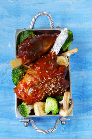 shin: Meat shin baked with tomato sauce with vegetables garnish