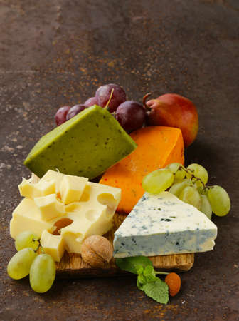 cheeseboard: cheeseboard with different types of cheese and grapes Stock Photo