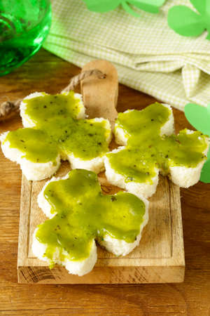 funny sandwiches in the form of clover with green cheese Patricks Day food photo