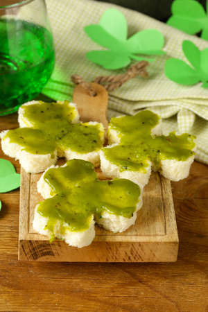 funny sandwiches in the form of clover with green cheese Patrick\ photo