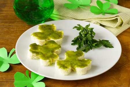 funny sandwiches in the form of clover with green cheese Patrick photo