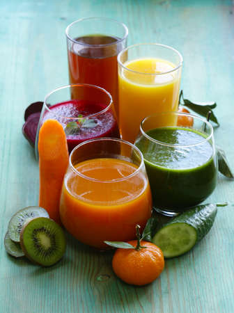 orange juice glass: assorted fresh juices from fruits and vegetables Stock Photo