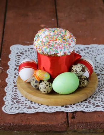 glace: Easter cake with glace icing and colored easter eggs rustic style Stock Photo