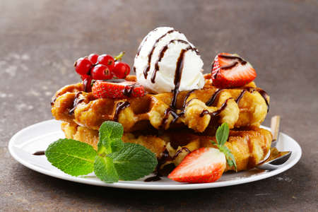 waffle: Belgian waffles with berries (currants, strawberries) and ice cream