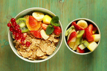 homemade granola muesli with fruit salad for breakfast photo