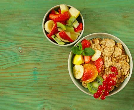 homemade granola muesli with fruit salad for breakfast photo