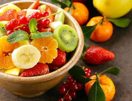 citruses: Fresh organic fruit salad (kiwi, strawberry, banana, currant, apple)