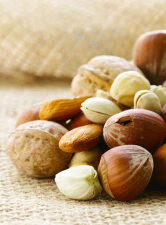 kinds: different kinds of nuts (almonds, walnuts, hazelnuts, pistachios) Stock Photo