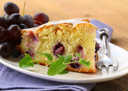 piece of homemade sweet pie with red grapes photo