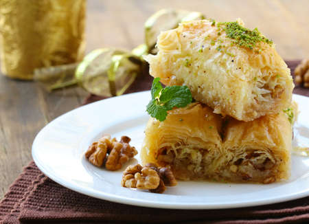 turkish dessert: Turkish arabic dessert - baklava with honey and walnut nuts Stock Photo