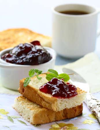 breakfast with fresh toast and cherry jam photo