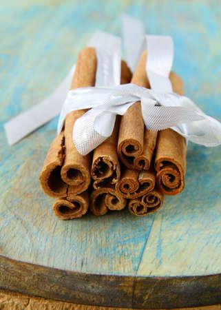 cinnamon sticks: Cinnamon sticks traditional spices on wooden background