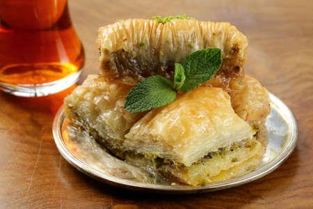 turkish dessert: Turkish arabic dessert - baklava with honey and walnut, pistachios nuts