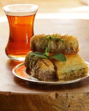 baklawa: Turkish arabic dessert - baklava with honey and walnut, pistachios nuts
