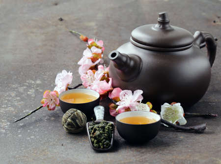 teapot: tea set (teapot, cups and different green tea) Stock Photo