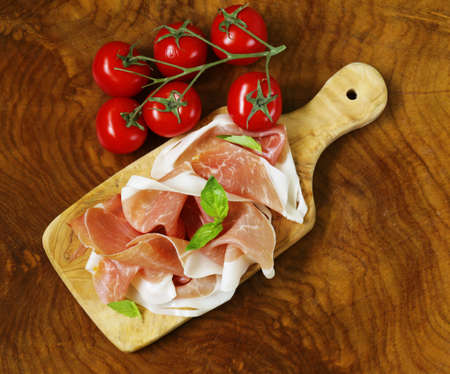 jamon: parma ham (jamon) with fragrant herbs traditional Italian meat appetizer