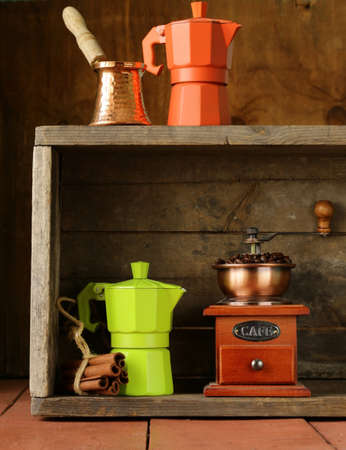 cezve: coffee beans and different utensils for boiling coffee (grinder, kettle, cezve)